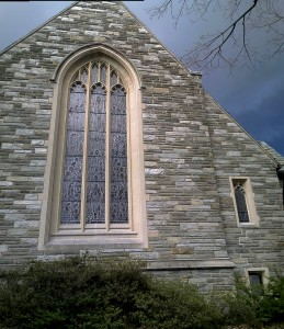 Dark clouds behind church
