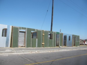 Houses for sale at a bus stop along Macassar Road in Khayelitsha